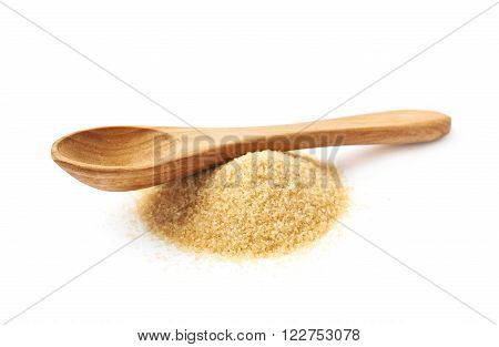 Wooden spoon over the pile of stevia cane sugar isolated over the white background