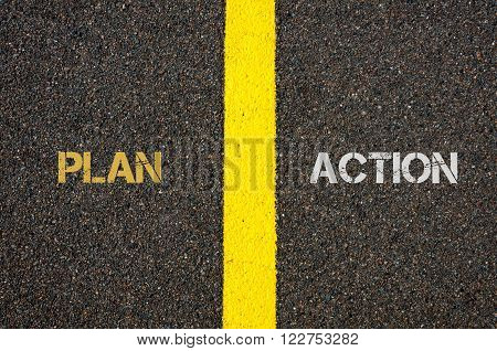 Antonym concept of PLAN versus ACTION written over tarmac, road marking yellow paint separating line between words