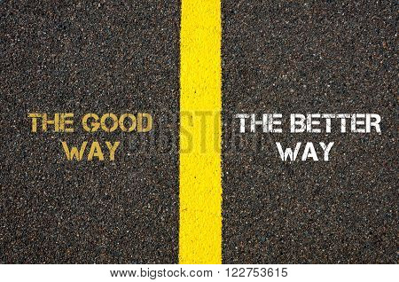 Antonym concept of THE GOOD WAY versus THE BETTER WAY written over tarmac, road marking yellow paint separating line between words