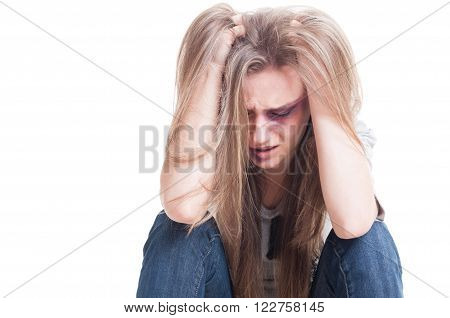 Domestic violence and despair concept with an abused and beaten woman