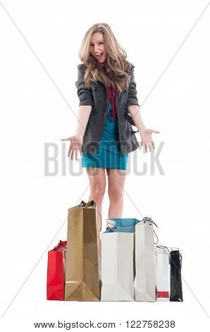 Excited and enthusiastic shopping female showing the shopping bags