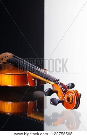 Old violin isolated on black and white background and glass desk ** Note: Shallow depth of field