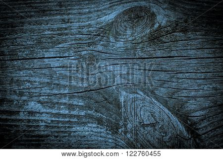 Wood texture with knots on bluish colored.