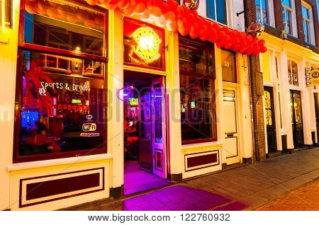 AMSTERDAM-APRIL 27: Local restaurant in red light district invites guests to have dinner on April 272015 the Netherlands.