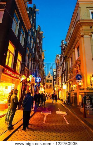 AMSTERDAM-APRIL 27: Nightlife on Amsterdam narrow street in red light district on April 272015 the Netherlands.