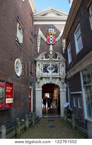 AMSTERDAM, NETHERLANDS - APRIL 27: Entrance of the Amsterdam Museum with the coat of arms of Amsterdam above the entrance to the museum on April 27, 2015 in Amsterdam.
