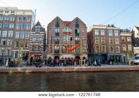 AMSTERDAM NETHERLANDS-APRIL 27: Famous Amsterdam Bulldog coffeeshop and hotel in red-light district on King's Day on April 272015. King's Day is the largest open-air festivity in Amsterdam.