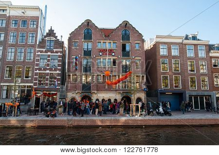 AMSTERDAM-APRIL 27: One of the most visited Bulldog coffeeshop and hotel in red-light district people celebrate King's Day outside the cafe on April 272015 the Netherlands.