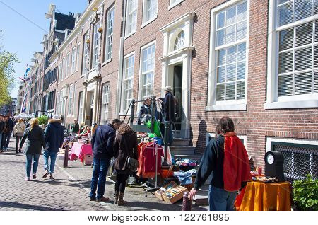 AMSTERDAMNETHERLANDS-APRIL 27: Street market of bric-a-brac during King's Day on April 27 2015. King's Day is the largest open-air festivity in Amsterdam.