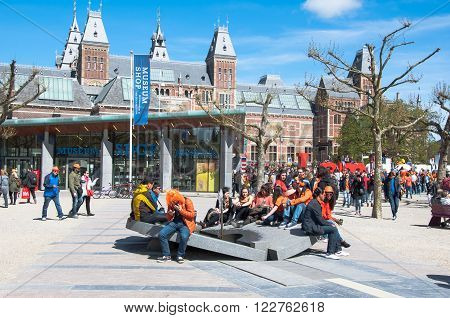 AMSTERDAM-APRIL 27: Crowd of people at the Museumplein during King's Day on April 272015. Museumplein is a public space between three museums: Rijksmuseum Van Gogh Museum and Stedelijk Museum.