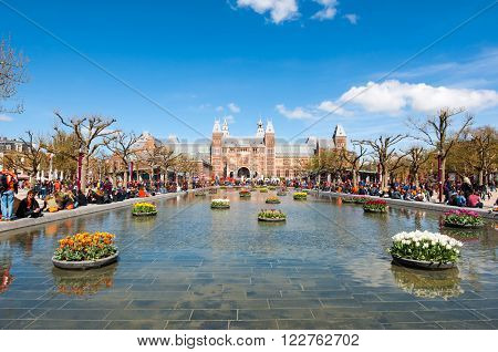 AMSTERDAM-APRIL 27: The Rijksmuseum from the Museumplein during King's Day on April 27 2015. The Rijksmuseum is the most important art museum in the Netherlands with thousands of old paintings.