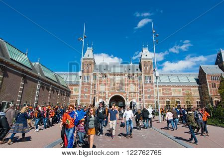 AMSTERDAM-APRIL 27: The Rijksmuseum during King's Day crowd of people go to Museumplein on April 27 2015.The Rijksmuseum is a Netherlands national museum dedicated to arts and history in Amsterdam.