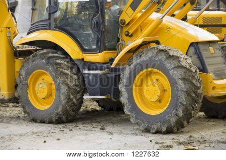 Yellow Wheels Of The Construction Vehicle On The Ground