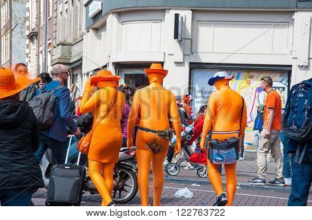 AMSTERDAM-APRIL 27: Locals and tourists in orange take part at celebration Koningsdag (King's Day) on April 272015 the Netherlands. King's Day is the largest open-air festivity in Amsterdam.