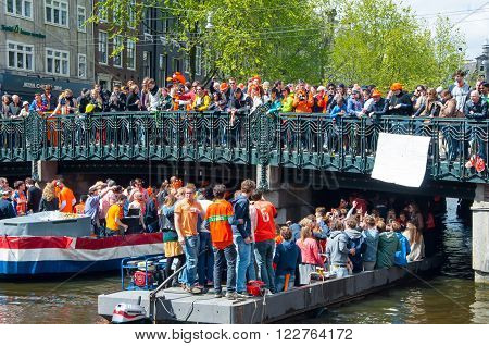 AMSTERDAM,  NETHERLANDS-APRIL 27: People celebrate King's Day on April 272015 in Amsterdam. King's Day is the largest open-air festivity in Amsterdam.
