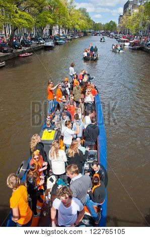 AMSTERDAM - APRIL 27: Local people on Party Boat with unlimited beer soda and wine aboard celebrate King's Day on April 27, 2015. King's Day is the largest open-air festivity in Amsterdam.