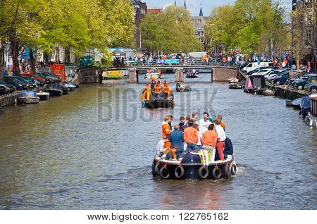 AMSTERDAM - APRIL 27: People on Party Boat with unlimited beer soda and wine aboard on King's Day on April 27, 2015. King's Day is the largest open-air festivity in Amsterdam.