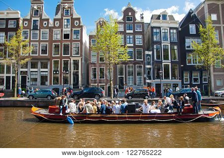 AMSTERDAM, NETHERLANDS - APRIL 27: Party Boat with unlimited beer soda and wine aboard on King's Day on April 27, 2015. King's Day is the largest open-air festivity in Amsterdam the Netherlands.
