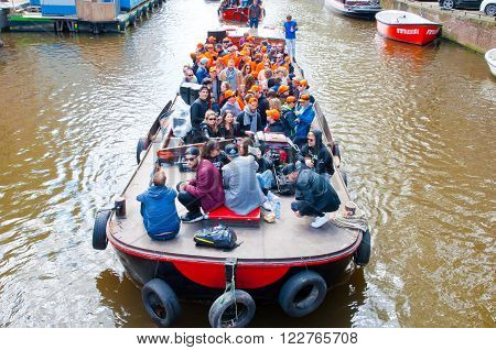 AMSTERDAM-APRIL 27: People on Party Boat with unlimited beer soda and wine aboard on King's Day on April 272015. Kings Day is biggest festival celebrating the birth of Dutch royalty.