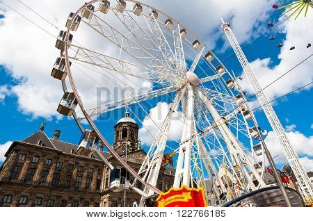 AMSTERDAMNETHERLANDS-APRIL 27: Big wheel on Dam Square during King's Day on April 272015 in Amsterdam. King's Day is the largest open-air festivity in Amsterdam.