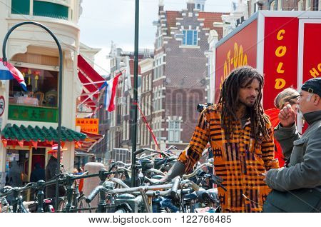 AMSTERDAMNETHERLANDS-APRIL 27: King's Day around red-light district on April 2727 in Amsterdam. The King Day is celebrated every year in April 27.