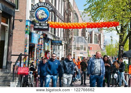 AMSTERDAMNETHERLANDS-APRIL 27: Amsterdam red-light district in the midday on King's Day on April 272015 the Netherlands. King's Day is the largest open-air festivity in Amsterdam.
