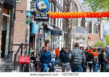 AMSTERDAMNETHERLANDS-APRIL 27: Amsterdam red-light district during King's Day on April 272015 the Netherlands. King's Day is the largest open-air festivity in Amsterdam.