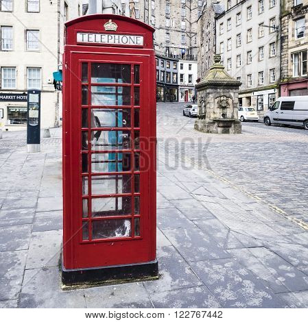 EDINBURGH, SCOTLAND - MARCH 4: Red phone booth in the Old Town of Edinburgh at March 4, 2016