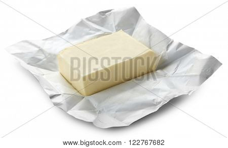 Piece of butter on paper, closeup