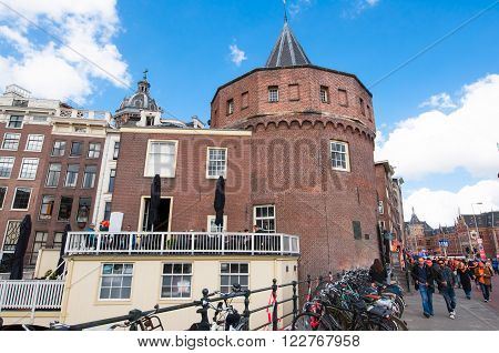 AMSTERDAM-APRIL 27: Amsterdam cityscape during King's Day with Schreierstoren in the background on April 272015 Netherlands. The Schreierstoren (Weeper's Tower) was part of the medieval city wall.
