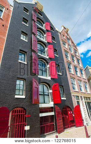 Amsterdam the Netherlands-April 27: Traditional colorfull Amsterdam building on April 272015. Amsterdam is the most populous city of the Kingdom of the Netherlands.