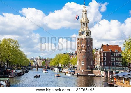 Amsterdam cityscape and the Montelbaanstoren tower on the left. The canal Oudeschans the Netherlands.