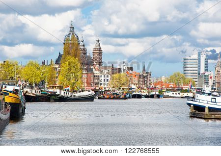 Amsterdam cityscape with St. Nicolas church dome in the background the Netherlands.