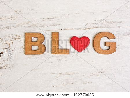 the word blog with wooden letters on a white background old wooden