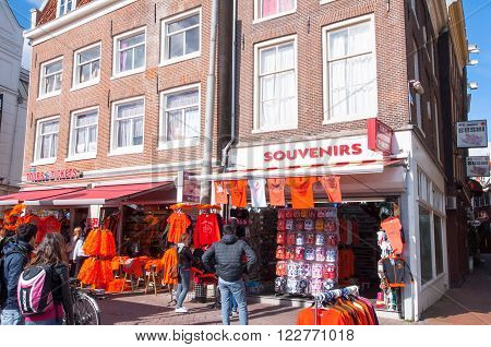 AMSTERDAM-APRIL 27: Souvenir shop on the Rokin street during King's Day on April 27 2015 in Amsterdam the Netherlands.