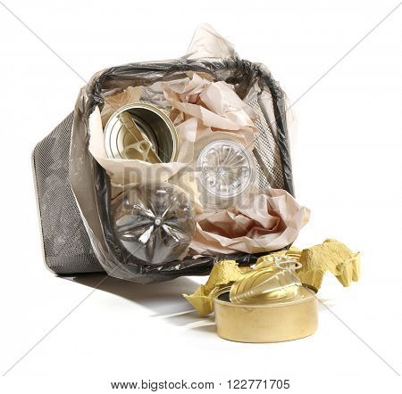 Full inverted garbage basket, isolated on white
