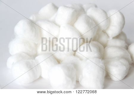 Cotton balls of a kind originally made from raw cotton used for cleansing wounds removing cosmetics.