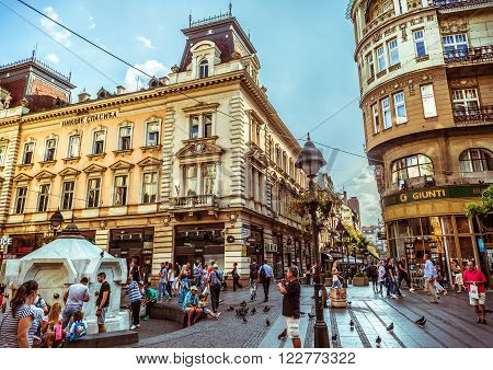 BELGRADE SERBIA - SEPTEMBER 23: Republic Square or Square of the Republic on September 23 2015 in Belgrade Serbia. One of the central town squares and an urban neighborhood of Belgrade. Filtered photo with warm summer lighting.