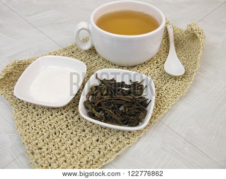 Green tea in cup with gelatin powder
