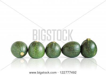 Five eight ball squashes isolated on white with reflection.
