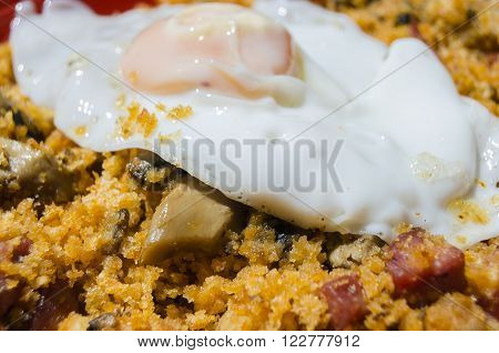 Traditional Spanish dish, breadcrumbs, egg and chorizo