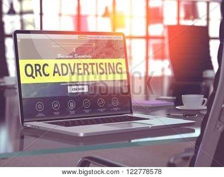 Modern Workplace with Laptop showing Landing Page with QRC - Quick Response Code - Advertising Concept. Toned Image with Selective Focus. 3D Render.