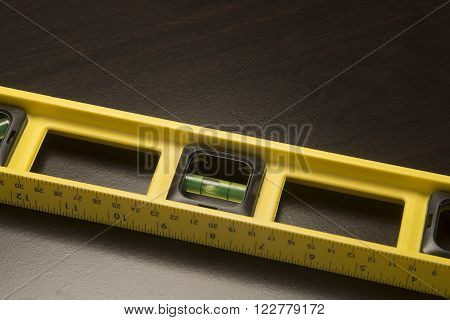 Yellow builders level for precision carpentry and construction