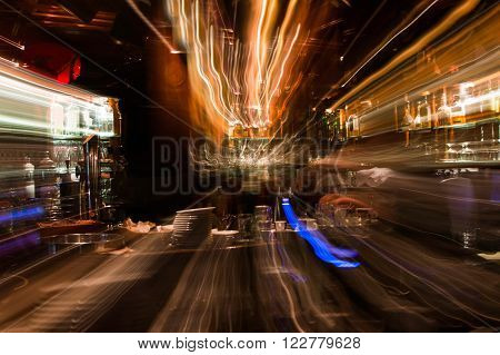 Abstract lighting motion effect background, lights in night bar, intentional zoom effect, nobody