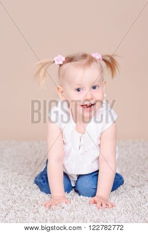 Cute baby girl 2-3 year old playing on floor in room. Childhood. Playful.