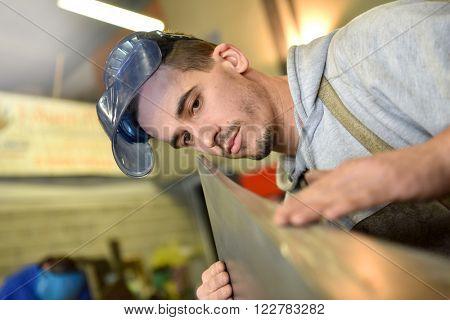 Metalworker working in workshop
