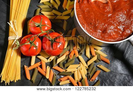 Ingredients for an Italian style meal on slate. Horizontal format.
