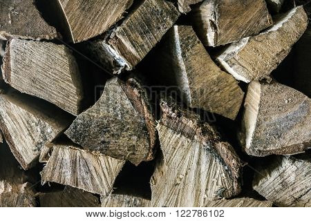 Birch forewood (fuelwood) foreground closeup on black background