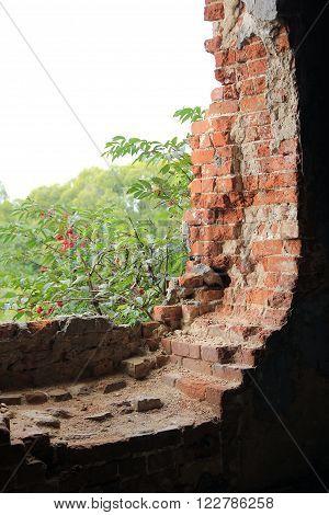Shattered brick window view near Vladimir city