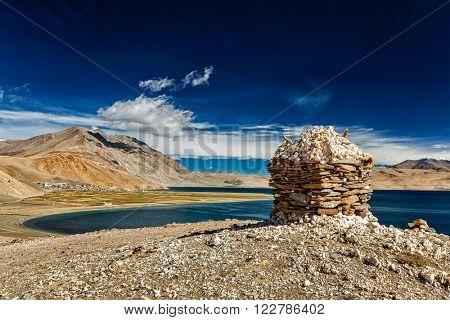 Stone cairn at Himalayan lake Tso Moriri, Korzok,  Changthang area, Ladakh, Jammu and Kashmir, India